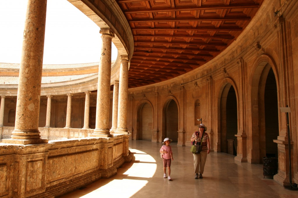 Syd and Kim walking in the Palace of Charles V in La Alhambra.
