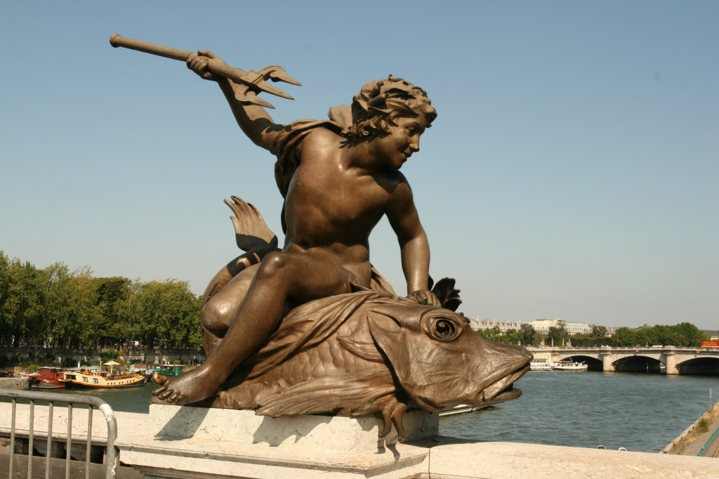 A statue on the Pont Alexandre III Bridge